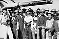 Crew of HMIS Narbada with blistered gun barrels following the bombardment of Myebon, Hunters Bay, Burma.jpg