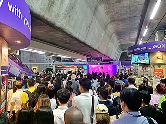 Crowded people on Asok BTS Station during the rush hour in Bangkok, Thailand Crowded BTS Asok Station.jpg