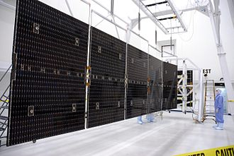 Solar cell - Dawn's 10 kW triple-junction gallium arsenide solar array at full extension
