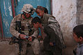 Defense.gov News Photo 100221-M-2311L-010 - U.S. Marine Corps Cpl. Hernandez left with Bravo Company 1st Battalion 6th Marine Regiment shows Afghan children a photograph he took in Marjah.jpg