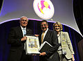 Defense.gov News Photo 120627-D-NI589-153 - Secretary of Defense Leon E. Panetta center is presented with a painting by President and CEO of the Military Child Education Coalition Mary.jpg