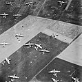 Discarded parachutes and Airspeed Horsa gliders lie scattered over 6th Airborne Division's landing zone near Ranville in Normandy, 6 June 1944. CL59.jpg