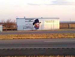 A water tank depicting Coahoma Justice of the Peace and well-known rodeo clown Quail Dobbs. Located on Interstate 20 near Coahoma.