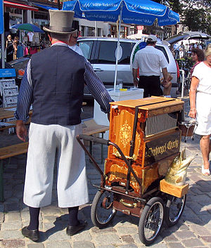 Barrel organ - A barrel organ player in Warnemünde, Germany.