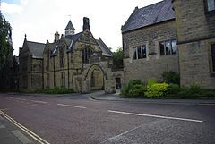 A picture of the front of Durham School taken from the road outside, illustrating the Kerr Arch in the centre.
