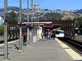 Eastbound train leaving Rockridge station, October 2017.JPG