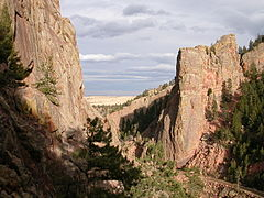 View from the climbers access trail to the Redgarden Wall a portion of which can be seen on the left. The Bastille sits across South Boulder Creek to the right.
