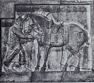 A bas relief of a soldier and the emperor's horse, Autumn Dew, with elaborate saddle and stirrups, designed by Yan Liben, from the tomb of Emperor Taizong c. 650 Emperor Taizongs horses by Yan Liben.jpg