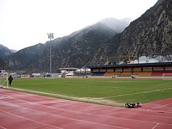 The pitch, covered stands, and all-weather athletics tracks at the national football stadium