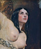 topless woman chained to a rock