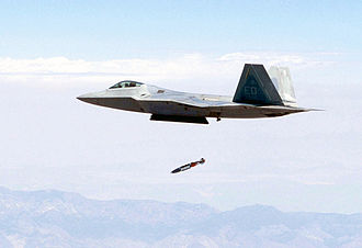Precision-guided munition - A F-22 releases a JDAM from its center internal bay while flying at supersonic speed
