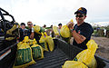 FEMA - 36609 - St. Charles city employees load sand bags into a truck in Missouri.jpg