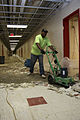 FEMA - 41330 - Worker removes floor tiles at a school in Kentucky.jpg