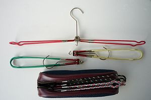 Clothes hanger - Foldable clothes hanger with sheath, about 1960