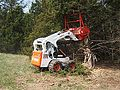 Fecon Bull Hog on Bobcat skid steer.jpg