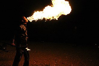 A fire breather at a Bedouin encampment near Marrakesh, Morocco. Fire breather at a Bedouin Camp.jpg