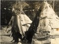 First Nations men stand in front of wigwams, Ontario, 03Q P907P33.tiff