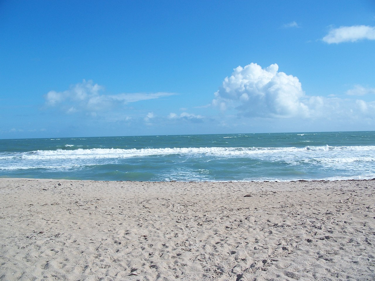 A fishing boat in rough seas off Fort Pierce Inlet State