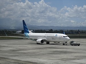 Sultan Iskandar Muda International Airport - A Garuda Indonesia aircraft being towed at Sultan Iskandar Muda International Airport to Jakarta