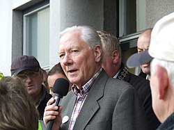 Gay Byrne speaking into a microphone in 2008