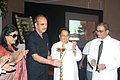 Ghulam Nabi Azad lighting the lamp at the launch of 'The Banerji Protocols' a new method of treatment with homeopathic medicines, in Kolkata. The Member Parliament, Shri Vijay J. Darda and the renowned film maker.jpg