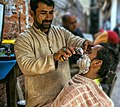 Grooming - Roadside Barbar is a common scene in rural areas and old cities of Pakistan.jpg