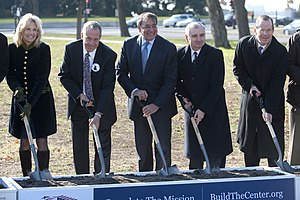 Jan Scruggs - Jan Scruggs, second from left, at the groundbreaking for the Education Center at Vietnam Veterans Memorial on November 28, 2012.
