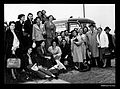 Group of young women standing hear a bus, apparently before migrating to Australia (8403972132).jpg