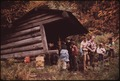 HIKERS FROM THE ADIRONDACK MOUNTAIN CLUB REST AT A LEANTO ON THEIR WAY UP YARD MOUNTAIN - NARA - 554667.tif