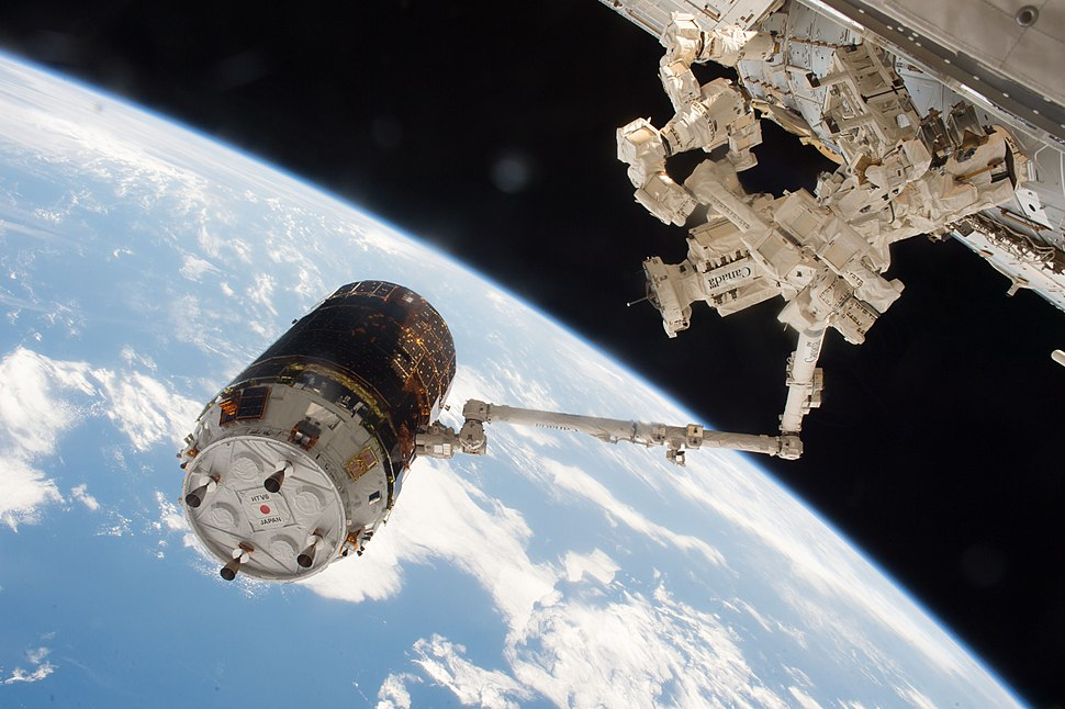 HTV-6 grappled by the International Space Station's robotic arm (2)
