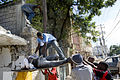 Haitians pull out a body from the rubbles of a school (12 january 2010).jpg