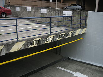 Parking lot - A sign at the entrance to an underground parking garage in March 2007, warning drivers of the maximum height clearance, in this case, roughly 2 meters (6.5 feet).