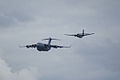Heritage Flight Boeing C-17A Globemaster III de Havilland CV-2B Caribou 62-4149 1st Pass 04 SNF 16April2010 (14443766120).jpg