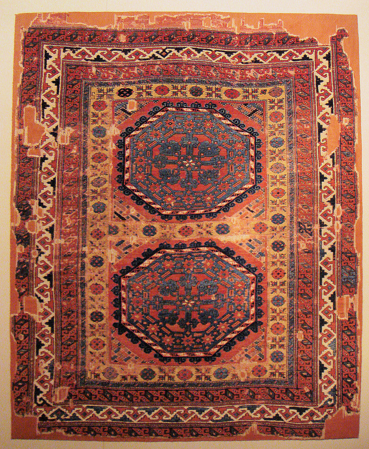 1200px-Holbein_carpet_with_large_medallions_16th_century_Central_Anatolia.jpg