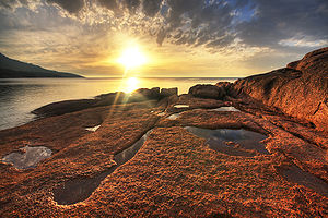 Sunset at Honeymoon Bay, Freycinet Peninsula, ...