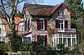 House from white Chalk-sand stone with colourful decorations at Oosterbeek - panoramio.jpg