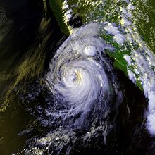 Satellite image of a tropical cyclone in the northeast Pacific ocean. The hurricane has a ragged eye.