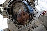 ISS-59 EVA-1 (p) Anne McClain takes a space-selfie.jpg