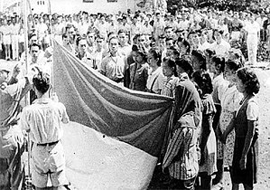 Flag of Indonesia - Hoisting of the Bendera Pusaka moment during the Proclamation of Indonesian Independence on 17 August 1945
