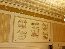 Wall, artwork, and ceiling inside courthouse