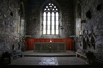 Fairy Flag - Iona Abbey: the effigy on the floor in the centre may mark the location of the burials of several MacLeod chiefs and one flag bearer.
