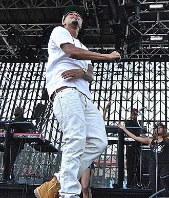 J. Cole - Cole performing in 2014