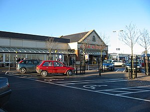 Nerston, South Lanarkshire - Modern development now encroaches the village: J Sainsbury at Kingsgate Retail Park, constructed on the former lands of West Nerston Farm during the 1990s.