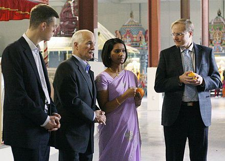 Layton and Rathika Sitsabaiesan with other NDP members are observing Hindu religious rituals at Town Hall before attending a meeting organised by the Canadian Tamil Community in 2010. Jack Layton in Town Hall Meeting in 2010.jpg