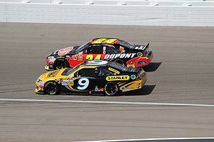 2012 NASCAR Sprint Cup Series - Marcos Ambrose, shown here with Jeff Gordon at Las Vegas, won his second career race at Watkins Glen.