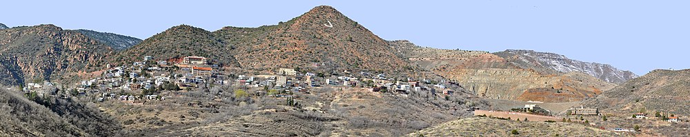 Panorama of Jerome's houses, commercial buildings, and mine sites spread along the flanks of a mountain marked with a large J
