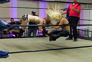Facebuster - Jillian Hall performing Solo (sitout facebuster) on Xandra Bale.