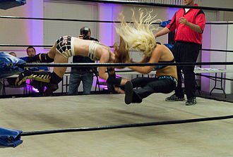Jillian Hall - Hall performing a sitout facebuster on Xandra Bale.