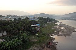 Looking west along the Mekong river in the evening from the new bridge, prior to the redevelopment of the waterfront.