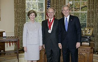 John Lewis Gaddis - U.S. President George W. Bush and First Lady Laura Bush standing with 2005 National Humanities Medal recipient John Lewis Gaddis on November 10, 2005 in the Oval Office at the White House.